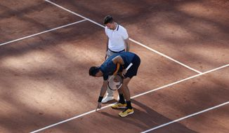 "In this Saturday, June 1, 2019, image, Argentina's Juan Martin del Potro points as he argues with umpire Manuel Absolu of France over whether a ball was in or out, during their third round match of the French Open tennis tournament at the Roland Garros stadium in Paris. There's a bit of choreography on clay seen at the French Open whenever a player disagrees with a line call. The chair umpire clambers down to the court, speed-walks over to locate the mark, thinks about it, then renders judgment, by holding an index finger aloft to indicate ""Out"" or holding a palm flat to indicate ""In."" (AP Photo/Pavel Golovkin)"