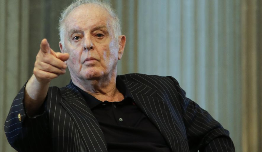 Daniel Barenboim, general music director of the Berlin State Opera and the Staatskapelle Berlin,  adresses a news conference about his contract in Berlin, Germany, Tuesday, June 4, 2019. Conductor Daniel Barenboim is getting a five-year contract extension as general music director of Berlin's Staatsoper, which would keep him at the opera house until 2027. (AP Photo/Markus Schreiber)