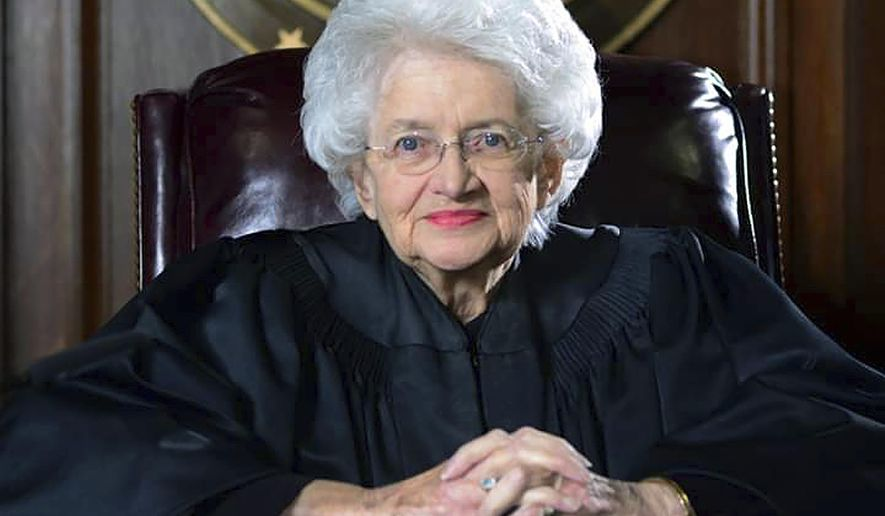 In this March 19, 2015 photo, U.S. District Judge Ellen Bree Burns poses for a portrait in her courtroom in the federal courthouse in New Haven, Conn. Burns who retired in 2015, was the first woman to serve on the federal bench in Connecticut. She died after a brief illness on Monday, June 3, 2019, at a hospital in New Haven. She was 95. (Christian Abraham/Hearst Connecticut Media via AP)