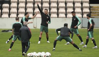 Portugal's Cristiano Ronaldo, center, gestures during a training session at the Bessa stadium in Porto, Portugal, Tuesday, June 4, 2019. Portugal will face Switzerland Wednesday in a UEFA Nations League semifinal soccer match. (AP Photo/Luis Vieira)