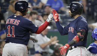 Boston Red Sox's Eduardo Nunez, right, celebrates with Rafael Devers (11) after hitting a three-run home run during the eighth inning of a baseball game against the Kansas City Royals Tuesday, June 4, 2019, in Kansas City, Mo. (AP Photo/Charlie Riedel)