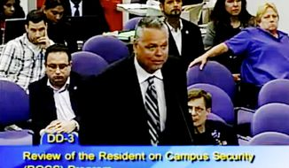 FILE - In this Feb. 18, 2015, file frame from video from Broward County Public Schools, school resource officer Scot Peterson talks during a school board meeting of Broward County, Fla. Peterson, the then-Florida sheriff's deputy assigned to protect the high school where 17 died in a 2018 shooting has been arrested on 11 charges, Tuesday, June 4, 2019. State Attorney Mike Satz announced that 56-year-old Peterson faces child neglect, culpable negligence and perjury charges. (Broward County Public Schools via AP, File)