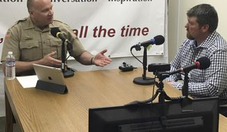 FILE - In this April 19, 2016, file photo, Sheriff Ozzie Knezovich, left, interviews Harney County Sheriff Dave Ward about the Malheur National Wildlife Refuge takeover for his weekly podcast on Spokane Talks Online in Spokane, Wash. Knezovich says he won't follow a new state law that forbids local officials from helping federal agents enforce some immigration laws. (Nina Culver/The Spokesman-Review via AP, File)
