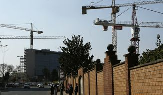 FILE - In this file photo dated Tuesday, Sept. 4, 2018, construction cranes tower over the city, in the Rosebank suburb of Johannesburg. South Africa's economy dropped by the largest amount in a decade, the government announced on Tuesday June 4, 2019, for the first quarter of 2019, hurting newly elected President Cyril Ramaphosa's efforts at growth and reforms. (AP Photo/Denis Farrell, FILE)