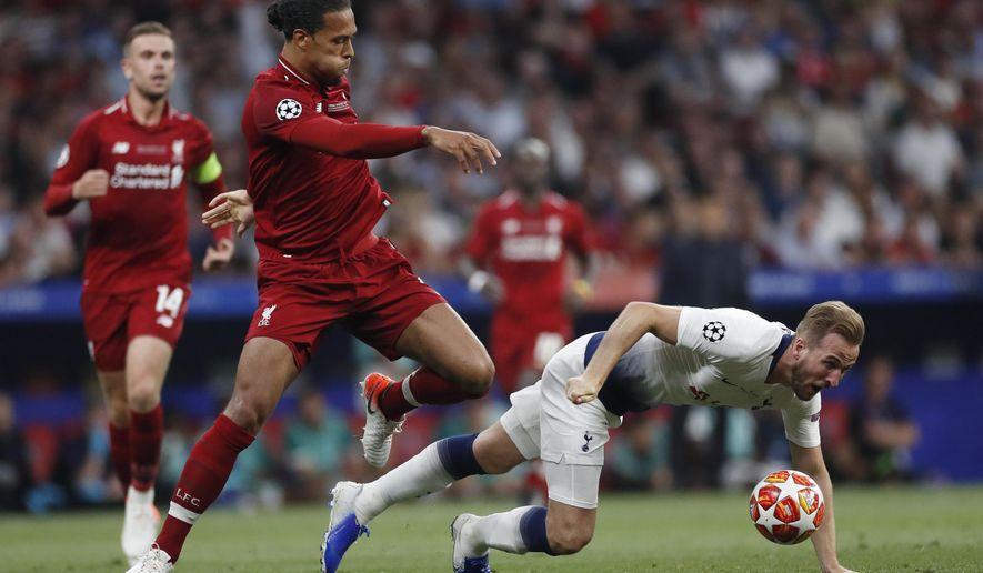 Tottenham's Harry Kane falls in front of Liverpool's Virgil Van Dijk during the Champions League final soccer match between Tottenham Hotspur and Liverpool at the Wanda Metropolitano Stadium in Madrid, Saturday, June 1, 2019. (AP Photo/Bernat Armangue)