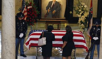 Mourners pay their respects following a funeral service for the late Republican Sen. Thad Cochran, in the Mississippi State Capitol rotunda in Jackson, Miss., Monday, June 3, 2019. Cochran was 81 when he died Thursday in a veterans' nursing home in Oxford, Mississippi. He was the 10th longest serving senator. (AP Photo/Rogelio V. Solis)