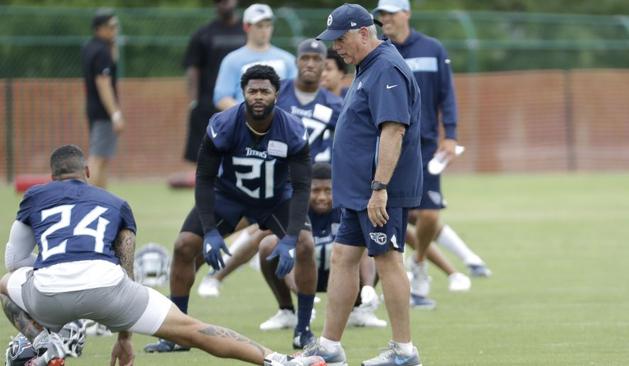 Tennessee Titans defensive coordinator Dean Pees, front right, talks with safety Kenny Vaccaro (24) and cornerback Malcolm Buter (21) during an organized team activity at the Titans' NFL football training facility Tuesday, June 4, 2019, in Nashville, Tenn. Pees wants more than the 39 sacks the Titans managed in 2018, putting them in a tie for 16th in the NFL. Pees has made it clear he's only worried about making sure the Titans do what's asked of them on defense. (AP Photo/Mark Humphrey)