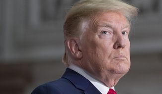 President Donald Trump pauses while speaking during a news conference with British Prime Minister Theresa May at the Foreign Office, Tuesday, June 4, 2019, in central London. (AP Photo/Alex Brandon)