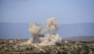 FILE - In this May 3, 2019 file photo, provided by the Syrian Civil Defense White Helmets, which has been authenticated based on its contents and other AP reporting, shows smoke rising after Syrian government and Russian airstrikes that hit the town of al-Habeet, southern Idlib, Syria. The violence raging once again in the northwestern province of Idlib, Syria's last rebel-held bastion, is putting Turkish-Russian relations to the test. (Syrian Civil Defense White Helmets via AP, File)