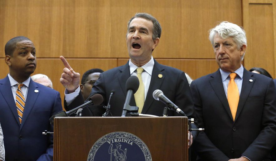 Virginia Gov. Ralph Northam, center, makes remarks as he held a news conference dealing with gun violence while Lt, Gov. Justin Fairfax, left, and Attorney General Mark Herring, right, look on inside the Patrick Henry Building in Richmond, Va. Tuesday, June 4, 2019. Northam is summoning lawmakers back to the state Capitol to consider a package of gun control legislation after Friday's mass shooting in Virginia Beach. (Bob Brown/Richmond Times-Dispatch via AP) ** FILE **