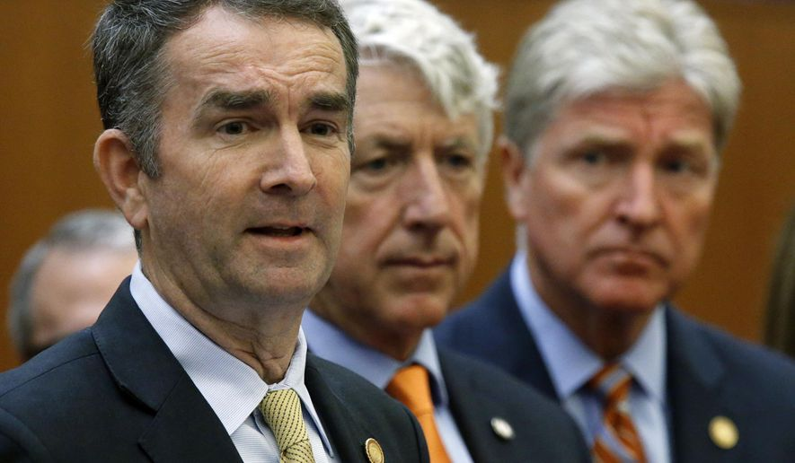 Virginia Gov. Ralph Northam, left, makes remarks at a press conference dealing with gun violence while Attorney General Mark Herring, center and Secretary of Public Safety and Homeland Security Brian Moran, right, look on inside the Patrick Henry Building in Richmond, VA Tuesday, June 4, 2019. The governor issued an executive order calling for a special session of the legislature later this month to deal with the situation. (Bob Brown/Richmond Times-Dispatch via AP)
