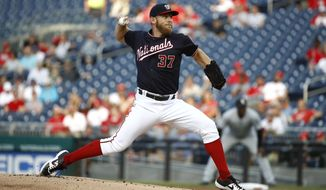 Washington Nationals starting pitcher Stephen Strasburg throws to the Chicago White Sox in the first inning of an interleague baseball game, Tuesday, June 4, 2019, in Washington. (AP Photo/Patrick Semansky)