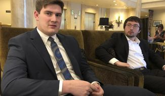 """Nathan Baring, left, and Alex Lozano, two plaintiffs that are part of a lawsuit by a group of young people who say U.S. energy policies are causing climate change and hurting their future, speak during an interview, Tuesday, June 4, 2019, with The Associated Press in Portland, Ore. Baring, who was 15 when he joined the lawsuit in 2015 and is now 19, said Tuesday he's disappointed the government has thrown up legal obstacles to the trial commencing. """"I just think its just really disappointing to see the lengths that they go to, to not only not let us get the remedy that we're seeking, by letting us have a chance to present or case at trial."""" (AP Photo/Andrew Selsky)"""