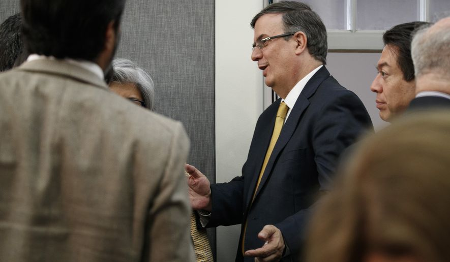 Marcelo Ebrard, Mexico's Secretary of Foreign Affairs, passes reporters as he leaves a news conference at the Embassy of Mexico, Wednesday June 5, 2019, in Washington. (AP Photo/Jacquelyn Martin)