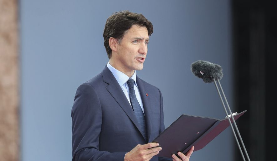 Canadian Prime Minister Justin Trudeau speaks during commemorations for the 75th Anniversary of the D-Day landings, in Portsmouth, England, Wednesday June 5, 2019. Commemoration events are marking the 75th Anniversary of the D-Day landings when Allied forces stormed the beaches of Normandy in northern France during World War II. (Chris Jackson/PA via AP)