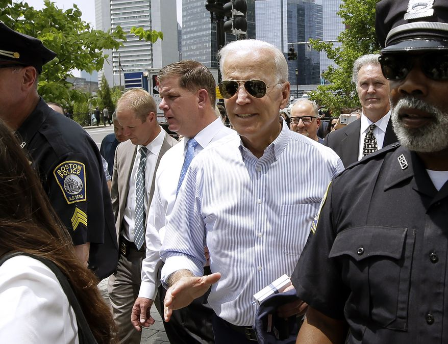 Former Vice President and Democratic presidential candidate Joe Biden walks with Boston Mayor Marty Walsh, left, on Wednesday, June 5, 2019, in downtown Boston. (AP Photo/Steven Senne)