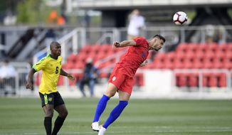 U.S. defender Matt Miazga (4) heads the ball next to Jamaica forward Dever Orgill (6) during the first half of an international friendly soccer match Wednesday, June 5, 2019, in Washington. (AP Photo/Nick Wass)