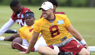 Redskins quarterbacks Case Keenum (8) and Dwayne Haskins Jr., behind Keenum, perform warm ups and stretches during a NFL football team's veteran minicamp at Redskins Park in Ashburn, Va., Wednesday, June 5, 2019. (AP Photo/Manuel Balce Ceneta) ** FILE **