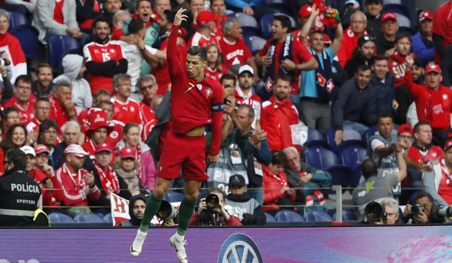 Portugal's Cristiano Ronaldo celebrates after scoring his side's opening goal during the UEFA Nations League semifinal soccer match between Portugal and Switzerland at the Dragao stadium in Porto, Portugal, Wednesday, June 5, 2019. (AP Photo/Armando Franca)