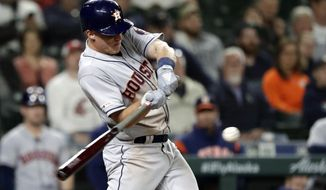 Houston Astros' Myles Straw singles in a run against the Seattle Mariners during the eighth inning of a baseball game Tuesday, June 4, 2019, in Seattle. (AP Photo/Elaine Thompson)