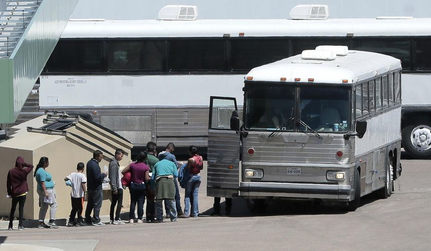 FILE - In this April 20, 2019 file photo, migrants are loaded onto a bus at the Border Patrol headquarters on Hondo Pass, in El Paso, Texas. The U.S. Border Patrol's apprehensions of migrants at the border with Mexico hit their highest level in more than a decade, as officials warned they don't have the money and resources to care for the surge of parents and children entering the country. Agents made 132,887 apprehensions in May 2019, the first time that apprehensions have topped 100,000 since April 2007. (Mark Lambie/The El Paso Times via AP File)