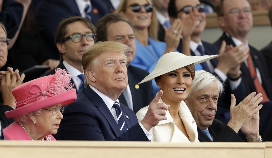 Queen Elizabeth II, President Donald Trump, first lady Melania Trump and Greek President Prokopis Pavlopoulos, from left, applaud as they watch a fly past at the end of an event to mark the 75th anniversary of D-Day in Portsmouth, England Wednesday, June 5, 2019. World leaders including U.S. President Donald Trump are gathering Wednesday on the south coast of England to mark the 75th anniversary of the D-Day landings. (AP Photo/Matt Dunham)