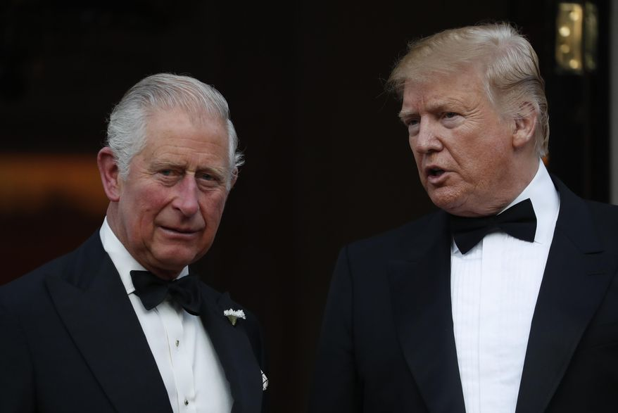 US President Donald Trump and Britain's Prince Charles pose for a photo, outside Winfield House, the residence of the Ambassador of the United States of America to the UK, in Regent's Park, London, prior to the Return Dinner as part of his state visit to the UK, Tuesday June 4, 2019. (AP Photo/Alastair Grant)