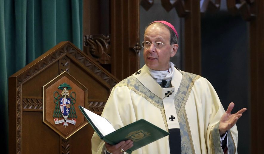 "FILE - In this March 28, 2017, file photo, Baltimore Archbishop William Lori leads a funeral Mass in Baltimore. On Wednesday, June 5, 2019, Lori released a report on an investigation into former Roman Catholic Bishop Michael Bransfield, in West Virginia, that found a ""consistent pattern"" of sexual innuendo and suggestive comments and actions toward subordinates. (AP Photo/Patrick Semansky, File)"