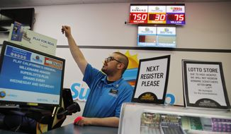 FILE - In this March 27, 2019, file photo cashier Edward Kelliher sells lottery tickets at the Lotto Store at Primm just inside the California border near Primm, Nev. On Wednesday, June 5, the Institute for Supply Management, a trade group of purchasing managers, issues its index of non-manufacturing activity for May. (AP Photo/John Locher, File)