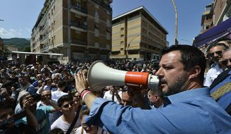 Italian Deputy Premier and Interior Minister Matteo Salvini addresses a rally in Ascoli Piceno, Italy, Wednesday, June 5, 2019. The European Commission recommended Wednesday that legal action be launched against Italy because it failed to respect EU debt rules last year and is likely to do so again in 2019 and 2020, setting up a new confrontation with the populist government in Rome. The Italian government only won commission approval for its 2019 budget plan late last year. After some early defiance from Salvini, Rome agreed to reduce the deficit to acceptable levels. (Sandro Perozzi/ANSA via AP)