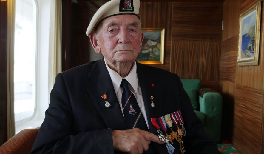 D-Day Veteran Donald Hitchcock poses for a photo wearing his campaign medals aboard the MV Boudicca ship as veterans return to the scene of the D-Day landings 75-years after the Allied invasion of northern France, Tuesday June 4, 2019. Hitchcock is desperate to spend D-Day commemoration on Omaha Beach with the Americans he served alongside all those years ago. Many veterans are returning to the scene where as young men they stormed the beaches of Normandy in northern France during World War II, with the fate of the free world resting on their shoulders. (AP Photo/Ben Jary)