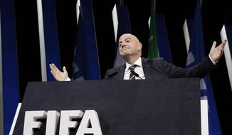 FIFA President Gianni Infantino gestures as he walks on the stage before the start of the 69th FIFA congress in Paris, Wednesday, June 5, 2019. (AP Photo/Alessandra Tarantino)