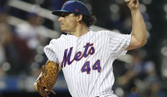 New York Mets starting pitcher Jason Vargas winds up during the sixth inning of the team's baseball game against the San Francisco Giants, Wednesday, June 5, 2019, in New York. (AP Photo/Kathy Willens)