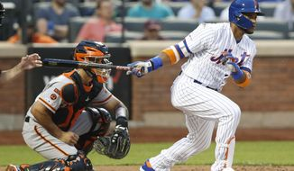 New York Mets' Robinson Cano, back in the lineup after a stint on the injured list, watches his groundout with the bases loaded during the third inning of the team's baseball game against the San Francisco Giants, Wednesday, June 5, 2019, in New York. Giants catcher Aramis Garcia is at left. (AP Photo/Kathy Willens)