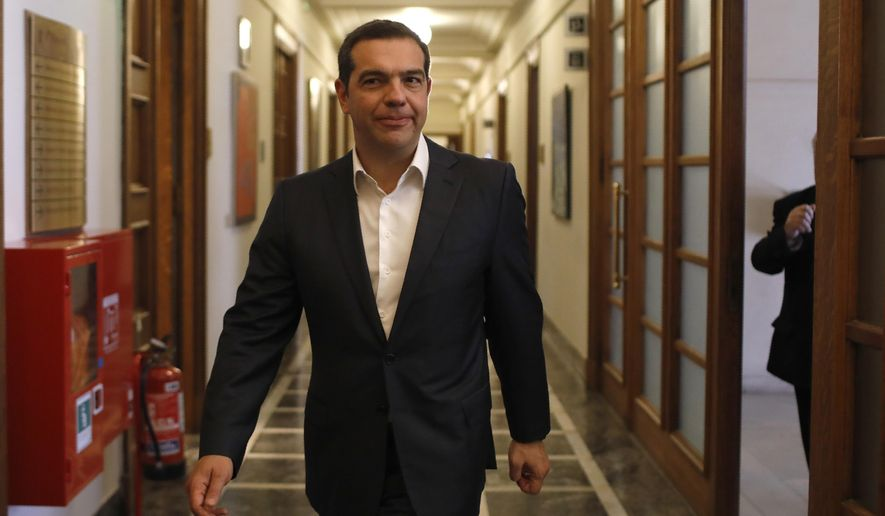 Greek Prime Minister Alexis Tsipras, arrives at  parliament to take part in a cabinet meeting in Athens, Friday, May 31, 2019. Greece's left-wing government says it is planning to appoint new top judges before a July 7 general election, a decision that has drawn criticism from opposition conservatives who hold a big lead in opinion polls. (AP Photo/Petros Giannakouris)