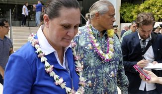 "FILE - In this Oct. 20, 2017 file photo, Katherine Kealoha, left, and her husband, former Honolulu Police Chief Louis Kealoha, leave federal court in Honolulu. The uncle federal prosecutors say a Hawaii power couple framed says he ""absolutely"" didn't steal their mailbox. U.S. prosecutors say framing Gerard Puana for stealing the mailbox was key to a conspiracy by Louis Kealoha and Katherine, a former deputy city prosecutor. The Kealohas are on trial, accused of framing Puana, Katherine Kealoha's uncle, to keep him from revealing a financial scheme that funded their lavish lifestyle. (AP Photo/Caleb Jones, File)"