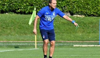 Italian national soccer team coach, Roberto Mancini, leads a training session ahead of Saturday's European Championship, Group J qualifying match against Greece, at Coverciano Sport Center, near Florence, Italy, Tuesday, June 4, 2019. (Claudio Giovannini/ANSA via AP)