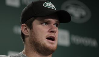 New York Jets quarterback Sam Darnold speaks to reporters at the team's NFL football training facility in Florham Park, N.J., Tuesday, June 4, 2019. (AP Photo/Julio Cortez)