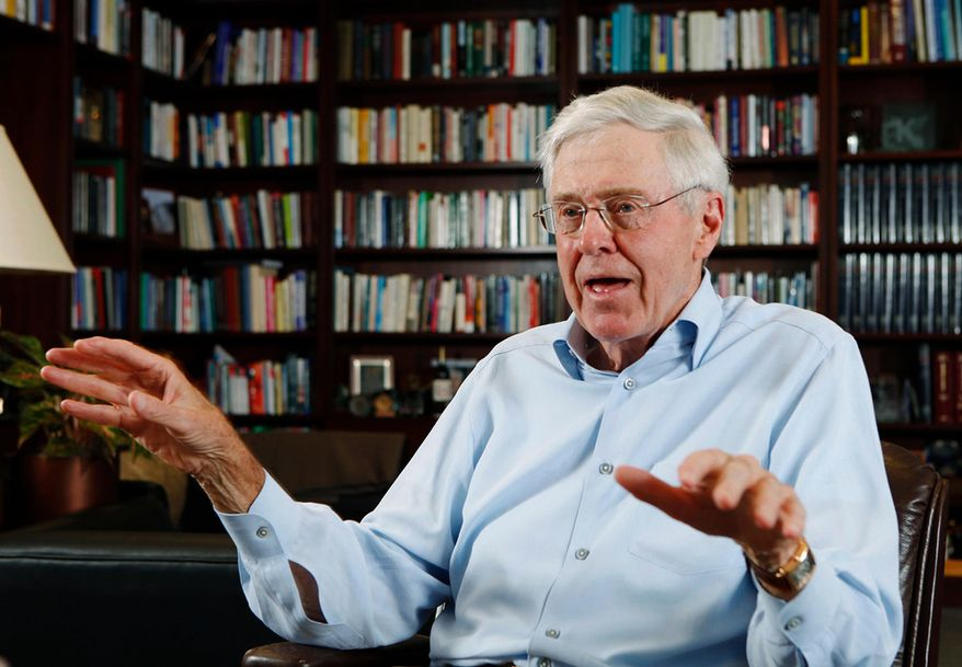 FILE - In this May 22, 2012, file photo, Charles Koch speaks in his office at Koch Industries in Wichita, Kan. If a billionaire's approach to philanthropy is a reflection of himself, Koch's latest initiative tackling poverty embodies both the wealthy industrialist's business acumen and the GOP political icon's distaste for big government. (Bo Rader/The Wichita Eagle via AP, File)
