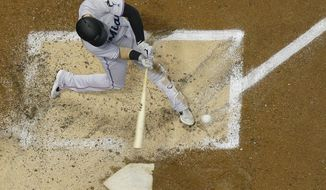 Miami Marlins' Brian Anderson hits a grand slam during the third inning of a baseball game against the Milwaukee Brewers Wednesday, June 5, 2019, in Milwaukee. (AP Photo/Morry Gash)