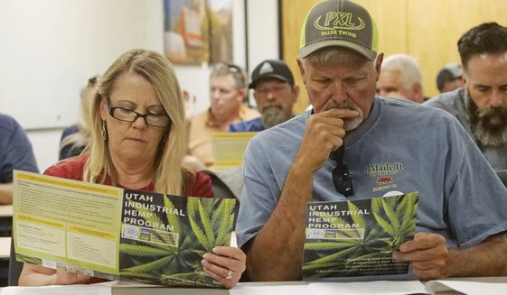 Alfalfa farmers Diane and Russ Jones look on during public hearing on medical cannabis at the Utah Department of Agriculture and Food Wednesday, June 5, 2019, in Salt Lake City, Utah. Potential marijuana growers raised concerns about the limitations of growing regulations at the public meeting held by agriculture officials about Utah's medical marijuana program. (AP Photo/Rick Bowmer)