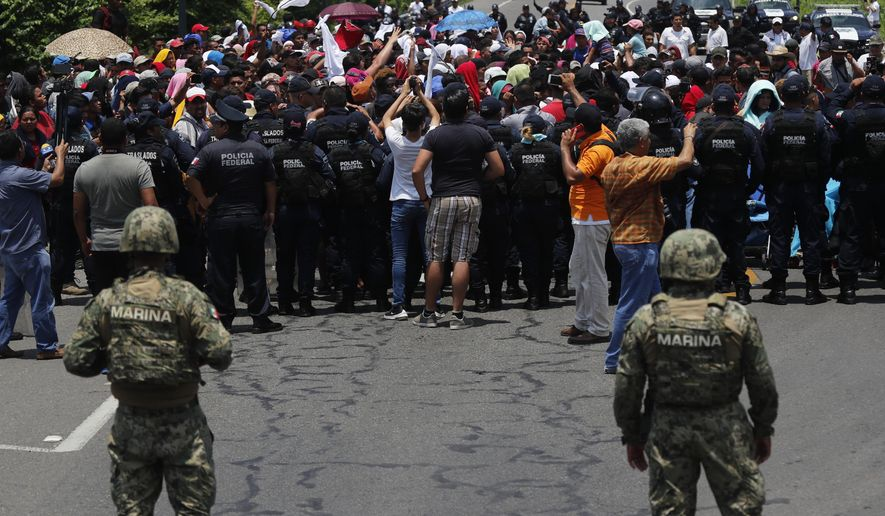 Mexican authorities stop a migrant caravan that had earlier crossed the Mexico - Guatemala border, near Metapa, Chiapas state, Mexico, Wednesday, June 5, 2019. (AP Photo/Marco Ugarte)