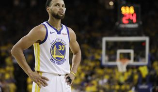 Golden State Warriors guard Stephen Curry (30) walks on the floor during the first half of Game 3 of basketball's NBA Finals against the Toronto Raptors in Oakland, Calif., Wednesday, June 5, 2019. (AP Photo/Ben Margot)