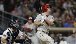 Philadelphia Phillies' Jay Bruce watches his grand slam during the fifth inning of the team's baseball game against the San Diego Padres, Tuesday, June 4, 2019, in San Diego. (AP Photo/Gregory Bull)