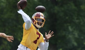 Washington Redskins quarterback Dwayne Haskins Jr., (7) throws the ball during an NFL football minicamp at Redskins Park in Ashburn, Va., Wednesday, June 5, 2019. (AP Photo/Manuel Balce Ceneta)