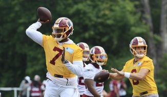 Washington Redskins quarterbacks Dwayne Haskins Jr., (7) and Case Keenum, right, throw during an NFL football minicamp at Redskins Park in Ashburn, Va., Wednesday, June 5, 2019. (AP Photo/Manuel Balce Ceneta) **FILE**