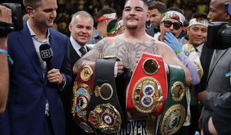 Andy Ruiz poses for photographs after a heavyweight title boxing match against Anthony Joshua on Saturday, June 1, 2019, in New York. Ruiz won in the seventh round. (AP Photo/Frank Franklin II)