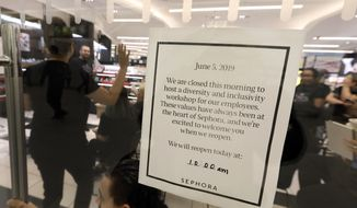 Sephora employees gather in one of the company's closed stores, in New York, Wednesday, June 5, 2019. Sephora is closing its U.S. stores for an hour Wednesday to host inclusion workshops for its employees, just over a month after R&B star SZA said she had security called on her while shopping at a store in California. (AP Photo/Richard Drew)
