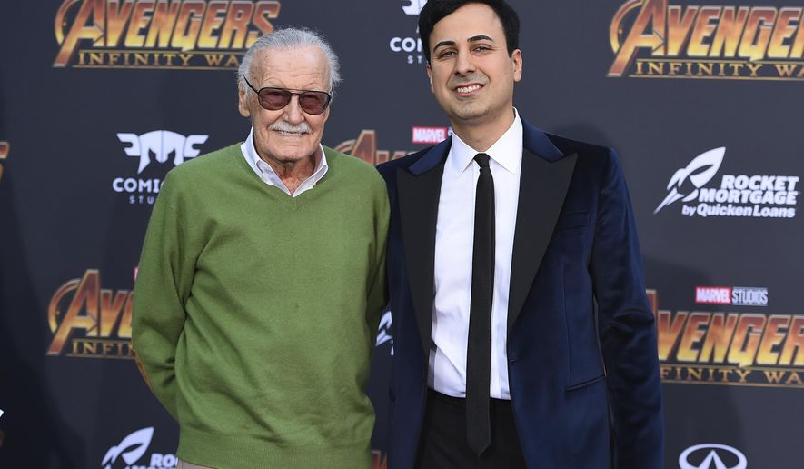 """FILE - In this April 23, 2018, file photo, Stan Lee, left, and Keya Morgan arrive at the world premiere of """"Avengers: Infinity War,"""" in Los Angeles. Morgan, a former business manager to Stan Lee, has pleaded not guilty to charges accusing him of abusing the Marvel Comics legend. (Photo by Jordan Strauss/Invision/AP, File)"""