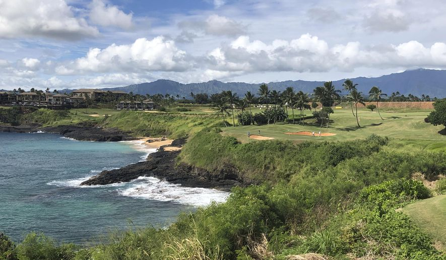 In this Nov. 15, 2018 photo, the 14th hole at the Hokuala Ocean Course in Lihue, Hawaii cuts across the Pacific Ocean on the east side of Kauai. On Tuesday, June 18, 2019, protesters formed a human chain and blocked tourists from using a Kauai highway to access an area they said cannot support a large influx of people, according to reports.  (AP Photo/John Marshall) **FILE**